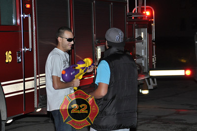 These guys just happen to be at the fire with water guns ? Notice the sunglasses at night. Both had them on. Last seen in a older silver car. Chased off fire scene by firefighters after attempting to take a video of them hitting the flames with the water gun.