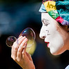 Title: Question of the Bubble<br /> Date: October 2010<br /> A clown at the Maryland Renaissance Festival, blowing bubbles.