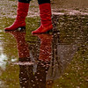 Title: Boots<br /> Date: April 2009 <br /> A woman's boots, in a puddle by the Tidal Basin, at the end of the Cherry Blossom season.
