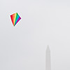 Title: Simple Rainbow<br /> Date: March 2009<br /> A rainbow kite flying near the Washington Monument during the 2009 Smithsonian Kite Festival.