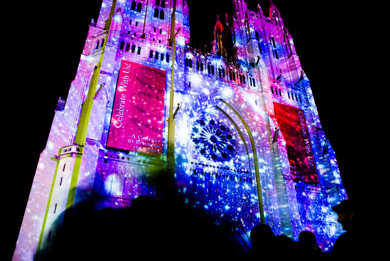 "Title: Lighting to Unite<br /> Date: May 2008<br /> The public light art display, called ""Lighting to Unite,"" projected onto the National Cathedral."