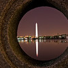 Title: Through the Looking Glass<br /> Date: March 2009<br /> The Washington Monument, through a porthole of a bridge over the Tidal Basin. At night.