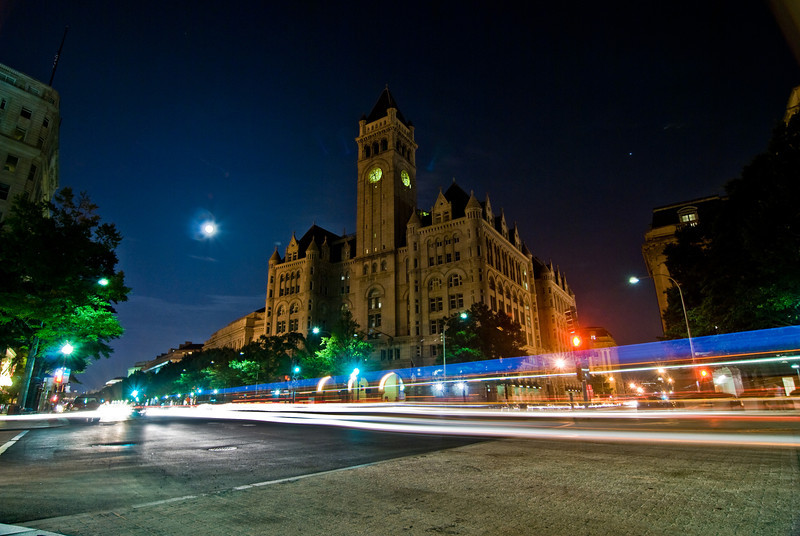 Title: Old Post Office<br /> Date: September 2009<br /> The Old Post Office, along Pennsylvania Avenue, at night, with a long exposure of a bus driving by.