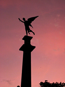 BA104.   El Arquero (The Archer).  Photographed from Recoleta Park at sunset.
