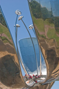 BA109.  Steel Flower, floralis Generica, La Flor Gigante de Buenos Aires, Naciones Unidis Square,  Made of stainless steel and aluminum, acts like a real flower - opens in day and closes at night. Weighs 18 tons and is 32 meters high.  It is set into a pool of water and reflects the city.