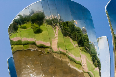BA110.  Steel Flower, floralis Generica, La Flor Gigante de Buenos Aires, Naciones Unidis Square,  Made of stainless steel and aluminum, acts like a real flower - opens in day and closes at night. Weighs 18 tons and is 32 meters high.  It is set into a pool of water and reflects the city.