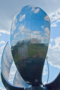 BA 133  Steel Flower, floralis Generica, La Flor Gigante de Buenos Aires, Naciones Unidis Square,  Made of stainless steel and aluminum, acts like a real flower - opens in day and closes at night. Weighs 18 tons and is 32 meters high.  It is set into a pool of water and reflects the city.