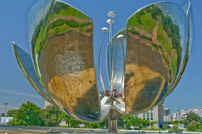 BA107.   Steel Flower, floralis Generica, La Flor Gigante de Buenos Aires, Naciones Unidis Square,  Made of stainless steel and aluminum, acts like a real flower - opens in day and closes at night. Weighs 18 tons and is 32 meters high.  It is set into a pool of water and reflects the city.