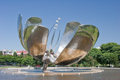 BA108.  Steel Flower, floralis Generica, La Flor Gigante de Buenos Aires, Naciones Unidis Square,  Made of stainless steel and aluminum, acts like a real flower - opens in day and closes at night. Weighs 18 tons and is 32 meters high.  It is set into a pool of water and reflects the city.