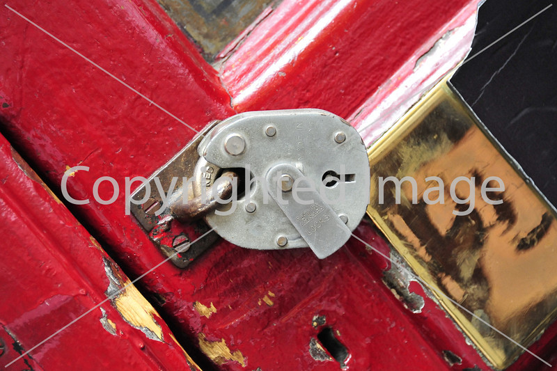 Padlocked red door