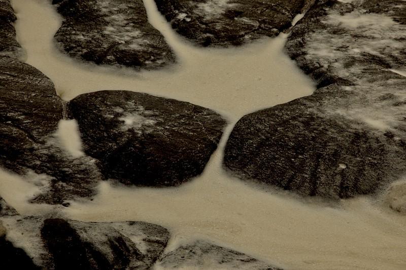 Surf foam and rock. Yachats, Oregon Coast.<br /> Photo © Carl Clark