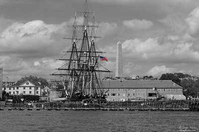 "The USS Constitution (""Old Ironsides"") and The Bunker Hill Monument both in Boston, MA.  The USS Constitution is a wooden-hulled, three-masted heavy frigate of the United States Navy. Named by President George Washington after the Constitution of the United States of America, she is the world's oldest commissioned naval vessel afloat. Constitution is most famous for her actions during the War of 1812 against Great Britain, when she captured numerous merchant ships and defeated five British warships: HMS Guerriere, Java, Pictou, Cyane and Levant. The battle with Guerriere earned her the nickname of ""Old Ironsides"". She has sailed as recently as last month to commemorate the 100th anniversary of the battle of 1812.  The Bunker Hill Monuments seen in the background is located further inland."