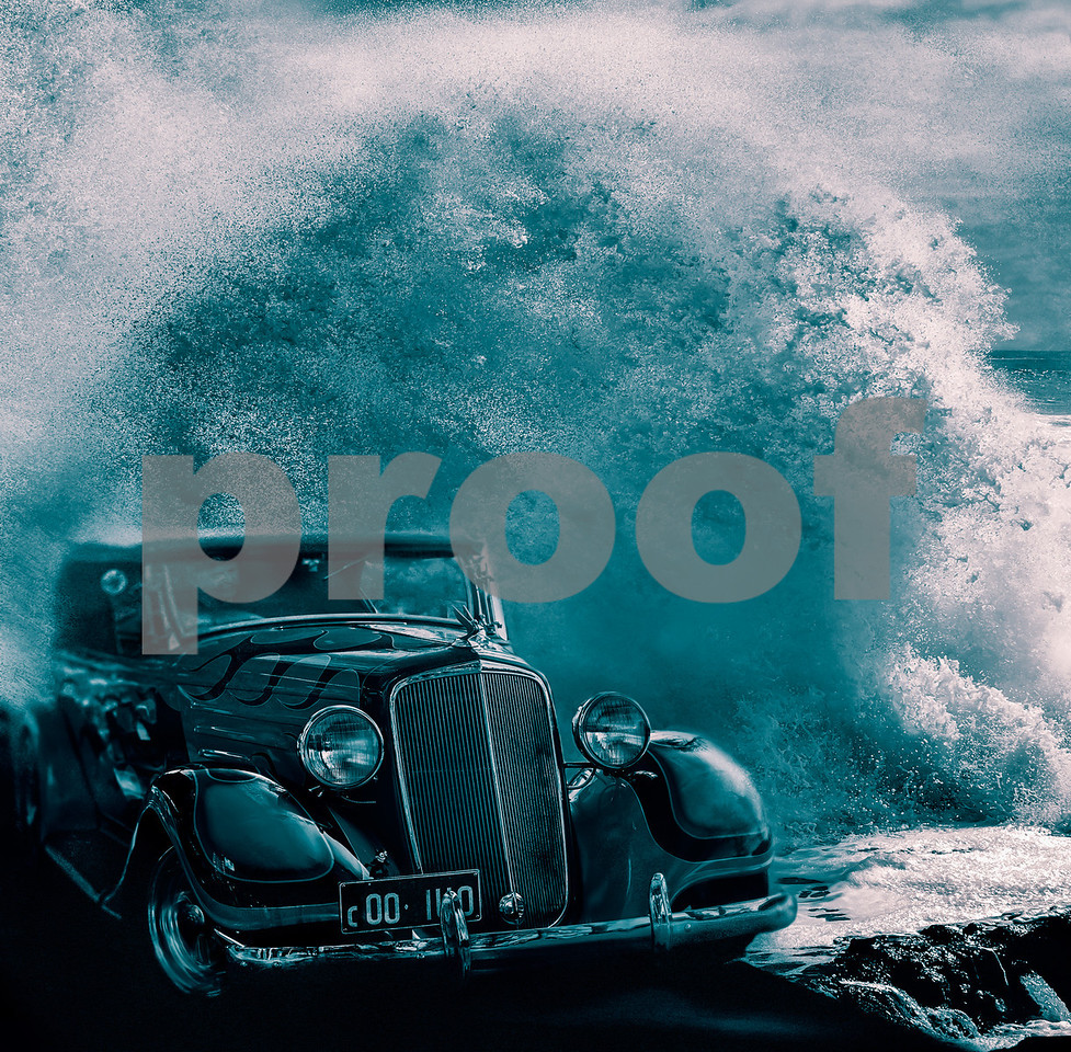 A vintage car with driver emerges from the surf