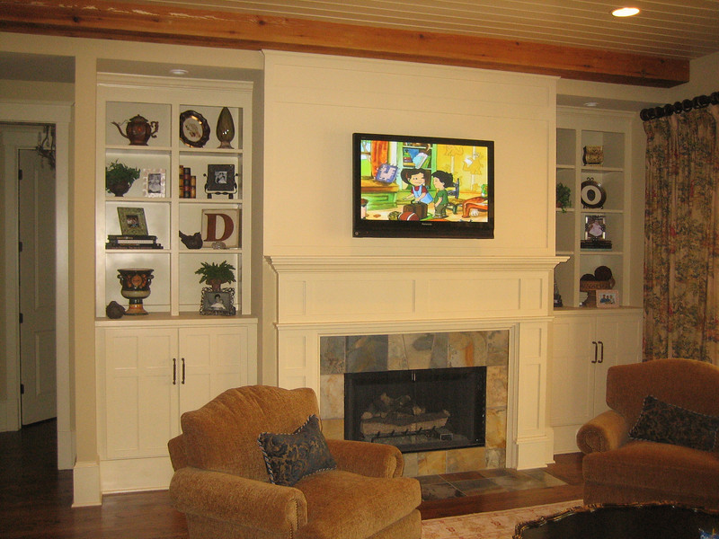 Custom Shaker style built-in units on either side of Nantuckett mantel; Note cabinet doors match mantel legs