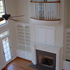 Built-in cabinets on either side of Fireplace mantel (South Hampton mantel) with TV niche above