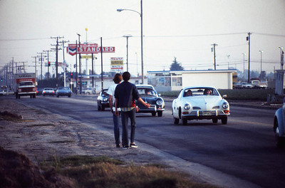 HITCHHIKERS Near Oxnard Airport  Here's something you saw a lot of in California back in the 70's -- hitchhiking. I once picked up a couple of hitchhikers on my way into town from the base one day and took them all the way down to Laguna Beach. It was quite an adventure, as my old Ford Falcon crapped out in Seal Beach on the way back at night and I had to take a bus back to the base to keep from being AWOL. I didn't get in until after midnight, but I got back. All it was was a loose generator belt.
