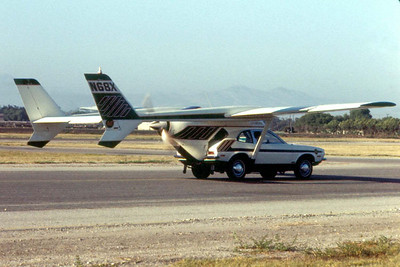 "ADVANCE VEHICLE ENGINEERS (AVE) ""MIZAR"" Oxnard Airport - August 1973  Very few people ever heard of this unusual experimental aircraft -- or much less even seen one -- but I happened to be at the Oxnard Airport one day while they were out performing tests on it. The AVE Mizar was the latest attempt at the creation of a viable flying automobile, or roadable aircraft, a commuter aircraft design that has fueled the imagination of aeronautical engineers for decades. (The flying surfaces are to detach from the vehicle, allowing the pilot/driver to use the vehicle as it was intended.) However, this particular design -- a Ford Pinto outfitted with full flight controls and attached to the wings, rear engine and tail assembly of a Cessna Skymaster -- failed during a flight test on September 11, 1973, and was destroyed."