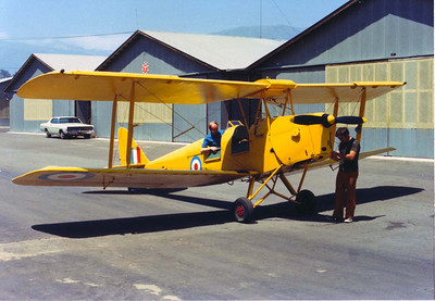 De HAVILLAND D.H.82 TIGER MOTH Santa Paula Airport - May 1975  And here's an antique now. That's Don sitting in the back seat, about to go up with a friend of his (the caretaker for the plane's owner). I would go up next, my first ride ever in a biplane.