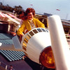 TOMORROWLAND ROCKET RIDE<br /> Disneyland, Anaheim, California - July 1974<br /> <br /> Normally, this is a kiddie ride, but we availed ourselves, anyway. I think this was to make up for the teacup ride. Mom could handle this, although she doesn't look too sure at this point.
