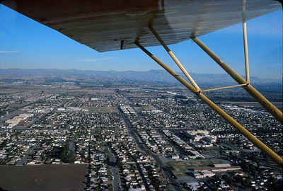OXNARD FROM THE AIR My buddy, Don Huiatt, got his pilot's license and bought himself an Aeronca Champ, and one day he and I flew to Santa Paula Airport, one of my favorite destinations. I just had to take a shot of Oxnard as we flew over. Not a bad little town; much larger than I thought.