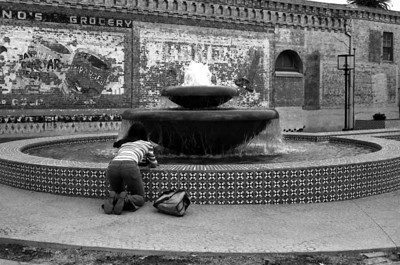 JANE SHOOTING FOUNTAIN It's not just Jane; I've always had a fascination with shooting other people shooting things. I always wonder what it looks like through their viewfinders -- how their eye sees things.