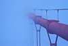 A typical San Francisco scene as a cable of the Golden Gate Bridge disappears in the fog.<br /> Photo © Carl Clark