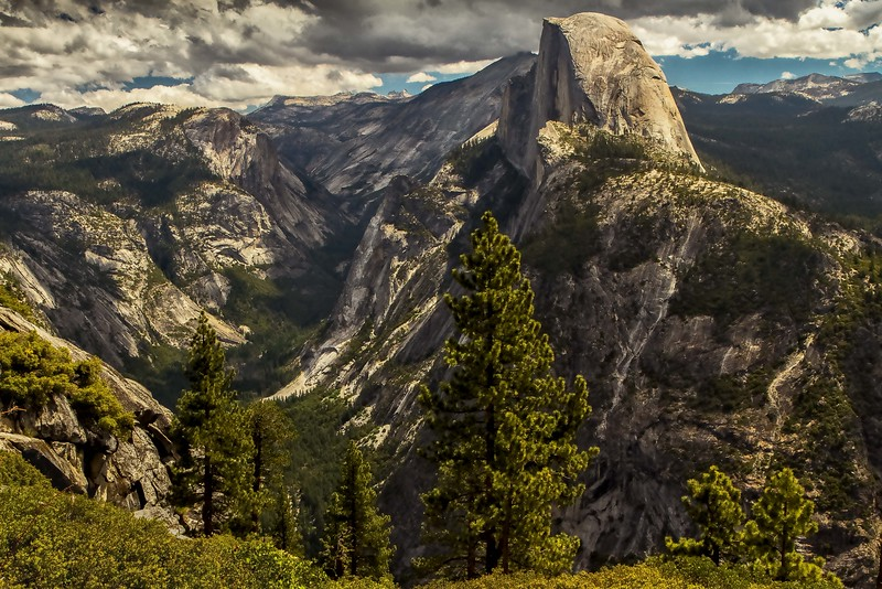 Magnificent vista - Half Dome and the Yosemite Valley.  The geological history of this place is fascinating!<br /> Photo © Cindy Clark