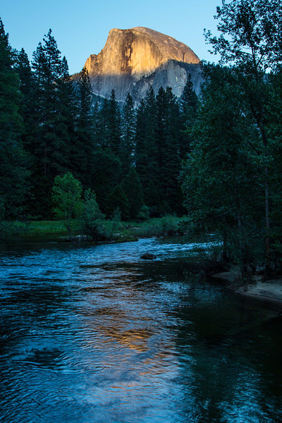 Half Dome refelcts the last light ot the day into the Merced River, Yosemite Valley.<br /> Photo © Carl Clark