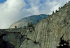 Granite walls of Yosemite with Half Dome looming above.<br /> Photo © Carl Clark
