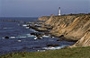 Calm waters lap the shore at the Point Arena Lighthouse.<br /> Photo © Carl Clark