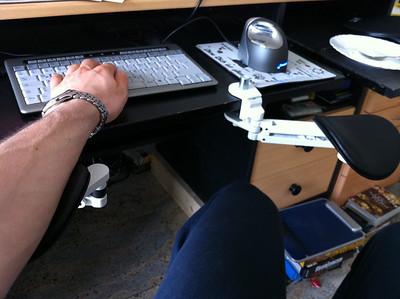 New ergonomic setup I'm testing (ErgoRest arm pads, flat keyboard with no numpad and Evoluent 4 vertical mouse)