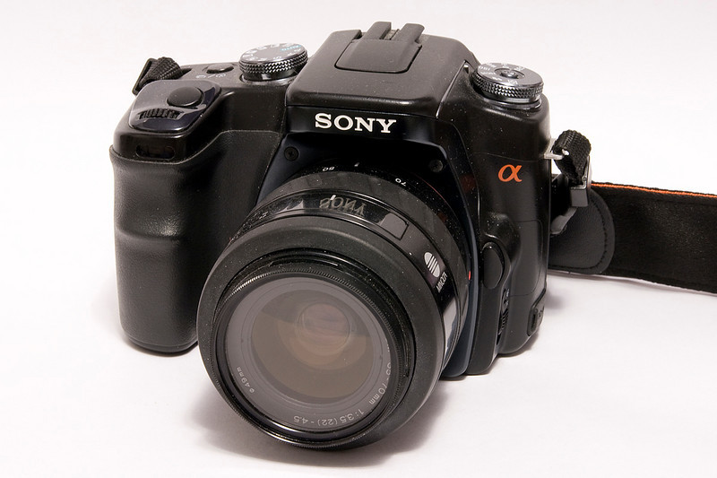 A Sony A100 coupled with a Minolta 35-70mm lens. This 10.2 MP DSLR uses a CCD (versus a CMOS sensor). This model was introduced in 2006.<br /> <br /> Traded in Dec of '09 for a Yashica Mat-124G in mint condition.