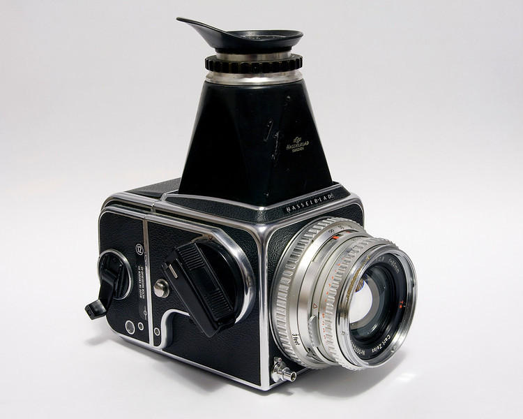 I was incredibly lucky to be able to purchase this Hasselblad 500 CM (made in 1973) with a 80mm Carl Zeiss lens (made in 1972), a A12 back, split screen focus screen and the view finder for pretty cheap ($200CDN!). I couldn't pass up on this great price. <br /> <br /> This camera is a medium format camera that results in square negatives using 120 or 220 roll film (12 or 24 photos) - depending on which film back you used. This particular copy was used in the local photo studio up until a few years ago. I can only imagine how many rolls of film was shot with this camera.<br /> <br /> I later purchased an adapter to use that lens on my Canon 40D. I'm not really sure why I did that, but it was fun using that lens on the 40D (hard to focus though when using the 40D).