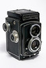 A Rolleicord III TLR (Twin Lens Reflex) - Model K3B, made between November 1950 - July 1953. This is a medium format camera that takes 120/220mm roll film. The resulting negatives are 2 1/4 x 2 1/4 inches (6cm x 6cm).