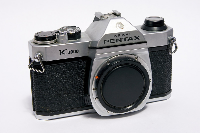 The more common (when compared to the Pentax K-1000 SE) Pentax K-1000 (this one was made in Hong Kong 1978-1990). Considering the SN, I would expect this copy to have been made later on - maybe late 1980's but that would just be a guess.<br /> <br /> A Pentax K-1000 was my first SLR, a serious upgrade from the 110 camera I was using at the time. <br /> <br /> In December of 2010, I gave this camera to a Niece as she wanted to get into b&w photography and wanted a older manual camera.