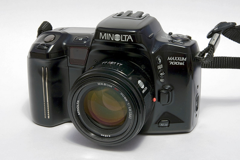 When I sold (darn it - never forgave myself that) my Pentax K-1000 because I had troubles with my eyes (so a manual focus camera wasn't going to work for me any longer), I ended up getting a Minolta 3xi (released 1991). <br /> <br /> I soon outgrew the 3xi and purchased this Minolta 700si (released 1993) selling the 3xi to friend (the sister of the guy who bought my K-1000 actually).<br /> <br /> I've since sold the 700si (January 2011).