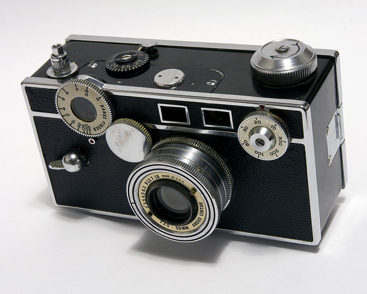Argus C2. <br /> <br /> This model was produced between 1938-1942. This particular copy was manufactured in 1941. Due to its dimensions and weight, the Argus C2 was referred to as 'the brick'. This particular brick is just that: a brick as it does not function properly at this time but I'm working on it and I'm getting closer!<br /> <br /> Darn sticky shutter!