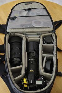 Older LowePro camera backpack with (left to right): Nikon 80-200 f/2.8 AF-D, with hood reversed; Nikon D7000 with AF300 f/4.0 ED-IF mounted; Nikon 28-105 AF-D, with hood in separate compartment.