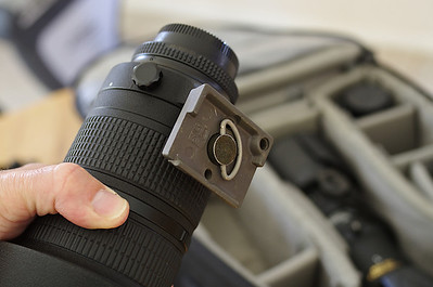 Close-up view of Manfrotto quick-release plate mounted on Nikon 80-200 f/2.8 AF-D.