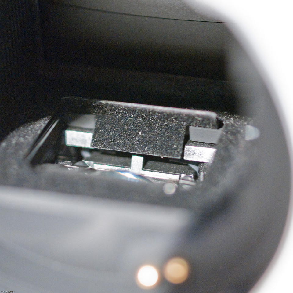 """Pentax K-5 autofocus box"" © Falk Lumo 2010 -- New autofocus box at the bottom of the K-5 mirror box. It looks different from a K-7 AF box. You can see the large lens in the front of the box."