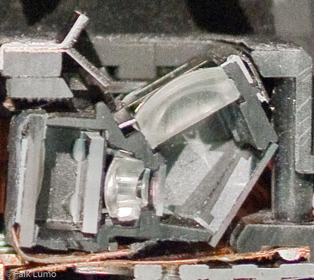 """Pentax K-5/7 cut model"" © Falk Lumo 2010 -- A cut model of the Pentax K-5 auto focus module as shown at Photokina 2010."