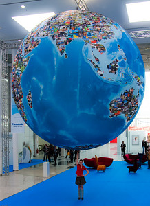 """""""Pictureword Girl"""" © Falk Lumo 2010 -- A Photokina 2010 press tour model holding the globe with one hand."""
