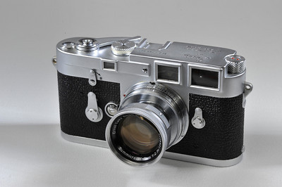 Leica M3 with 50mm f2 collapsible Summicron. Includes cap, 2 cases and strap. Condition is Mint minus.