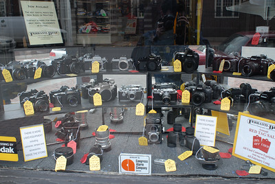 """""""How much is that camera in the window?"""" The window of Ferranti-Dege in Cambridge, MA across from Harvard University."""