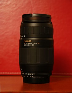 """This is the Tamron 75-300 f/4-5.6 LD zoom lens.  It's a fairly slow lens, so it sees limited use these days.  It's great in bright daylight, but it has some limitations to beware of, such as the """"dim tunnel viewfinder"""" effect due to the smaller f/4-5.6 apertures.  What can you expect for under $200 on a lens?  It's best used stopped down one or two f-stops.  At maximum zoom, some pictures can appear drab, so a little Photoshop trickery helps out.  With some care, this lens is capable of producing great pictures:    A good example of a creepy moon  Butterfly, to show off the """"macro"""" capability. Seaport Belle from Rowe's Wharf.  An example where the lens was zoomed out to 300mm and colors were somewhat drab, but Photoshop brought them out.   I have this lens up on eBay, as I've upgraded my lenses since I got this one.  A result of being bitten by the photography bug is the rabid desire for professional-quality gear (read, lots of $$$money$$$), and this particular lens is not professional-quality.  Update: This lens has been SOLD 4/29/2006!"""