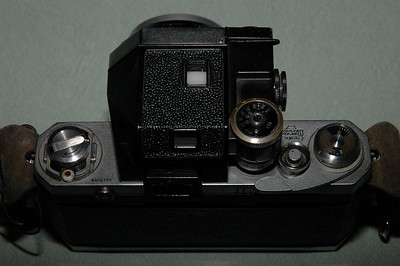 Top view of the Nikon F. You can see the serial number, the film rewind crank (folds out on a hinge), shutter release (has a red dot on it), film counter and film advance lever.
