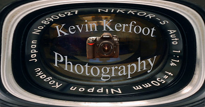 "My new logo.  Distorted the image of a lens on the Nikon F and put name and an image of my Nikon D200 ""in the lens."""