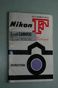 The original Nikon F Photomic user's manual.  The Nikon F was purchased by its original owner at Finn's Cameras in St. Paul, Minnesota.  By the way, Finn's Cameras is still in business, as a son of the owner recently got married.