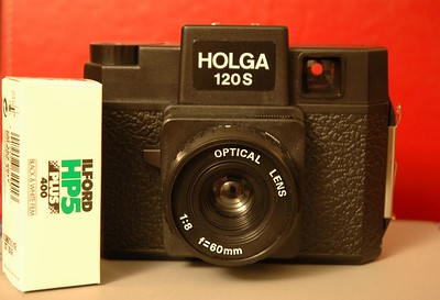 The Holga 120S is a medium-format camera which uses 120 film.  In stark contrast to the Nikon, this camera offers almost no control...there is an aperture lever with f/8 and f/11 stops and a focus ring, but no through-the-lens focusing.   Therefore, one must estimate distance to the subject, focus using icons on the lens barrel which map roughly to 3 ft., 9 ft, 18 ft., and 30 ft. to infinity.  Then simply press the shutter release lever (1/100 sec.) and advance to the next exposure manually.  Furthermore, the lens is made of plastic, as is almost every other part of the camera.  Some consider this a carnival toy camera, others see it as a tool for producing fine art.  Because of the manual film advancing, it is possible to (accidently or deliberately) double-expose a photo, and it's even possible to produce a panoramic effect.  As a result of the cheap construction and relative lack of quality control, light leaks abound, and no two cameras have the same optical characteristics.  People are known to seal these up with black gaffer tape to seal out light leaks, and others just let them in.  There is a legendary cult status around these cameras.  The pictures are typically vignetted, soft, often out of focus, and show signs of light leakage.  The results are often ethereal and dreamy looking, with the center in some degree of focus and more blurry towards the edges.  In the right hands, this thing can produce fine art.  I haven't used this camera lately, as developing the (uncommonly used) 120 format film is a lot more expensive than a typical roll of 35mm film.  It was great for a novelty though.  I understand that you can get a lot of the Holga effect on modern digital cameras by getting one of the Lensbaby lenses which sell for about $100.  And also I managed to find some Photoshop actions which simulate some of the unique optical characteristics of the Holga...though light leaks are not included.
