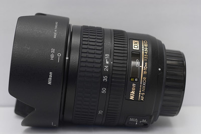 This is the Nikkor 18-70 f/3.5-4.5G AF-S ED lens, which sells as a kit lens with some Nikon Digital SLRs and served as my very first Nikon lens.  It has a nice silent focus motor and very good optics for its price ($200-300 these days.)  It's pretty sharp and has good color rendition.  Nikon's marketing and information page on this lens is located here.  There is noticeable barrel distortion and a bit of vignetting at 18mm, so I try to avoid using that part of the range when it's important to keep straight lines showing as straight near the frame edges.  Other than that and the somewhat smaller aperture, I have few complaints about this lens.  In the scheme of more pro-oriented optics I own, this is the most consumer-oriented lens I have, but I'll keep it, as it proves to be useful from time to time.